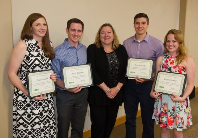 Cindy Smalley (center), board member of Delta Dental of Illinois Foundation, presented awards to SIU SDM students (L-R) Thais Meredith, Blake Ferando, Eric Safranski and Kasey Kirchner.