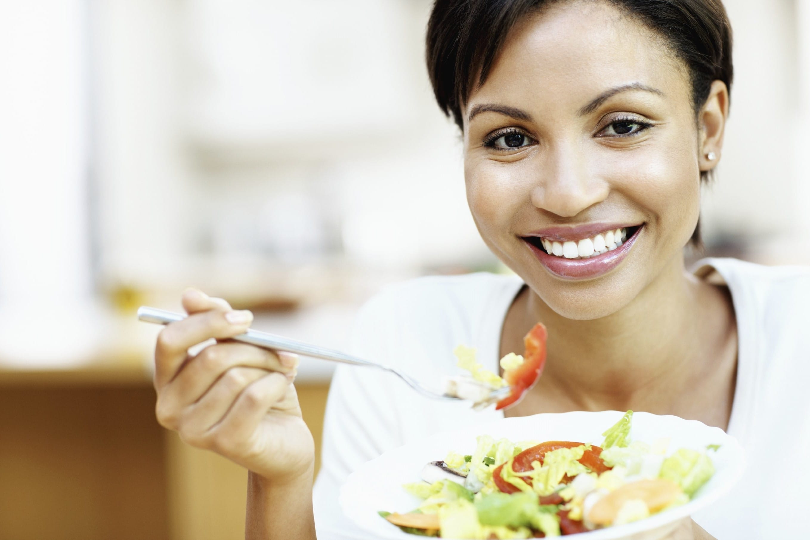 Lifestyle_Woman Eating Salad_African American