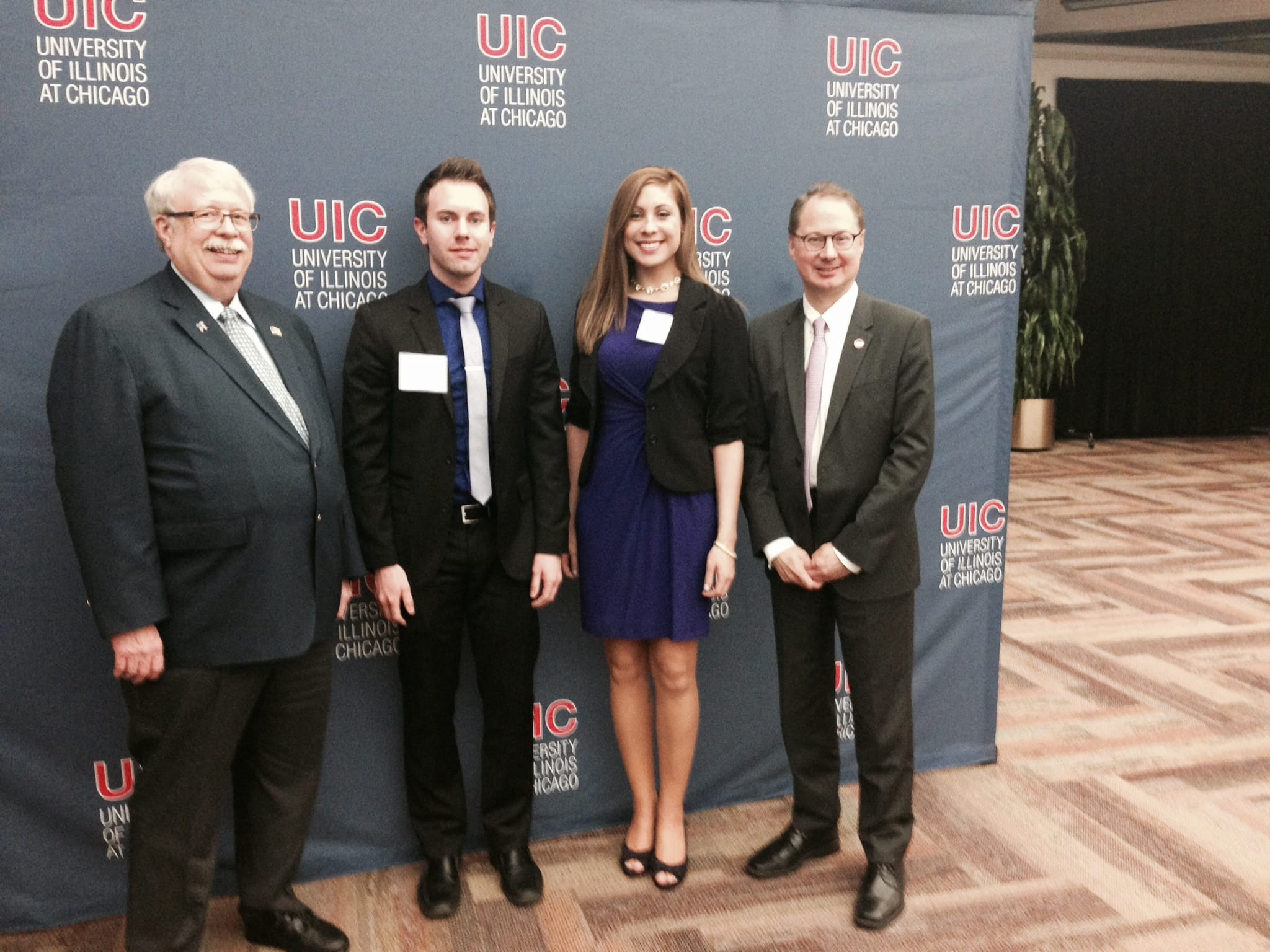 Delta Dental of Illinois Board member Craig Grannon, Christopher Greenwaldt, Jaime Chowaniec and UIC College of Dentistry Dean Dr. Clark Stanford